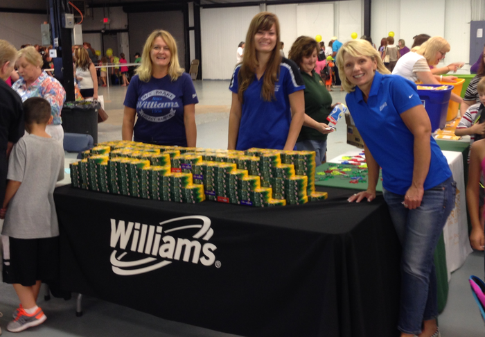 Jodi, Mollie and Michele gave out crayons donated by Williams employees to students.