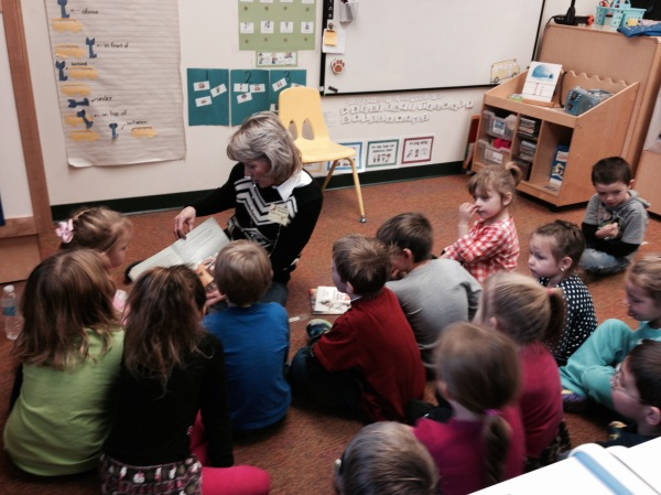 "Williams employee Michelle reads ""Pete the Cat"" to students of McNinch Elementary School."
