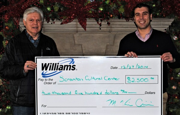 Williams employee Vince (left) presents Williams' donation to Paul Wendolowski, president of the SCC Board of Directors.