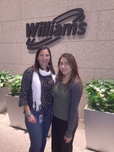 Maria Carlota Palacios and her intern Eloisa Cortinas pose in the lobby of our Houston tower.