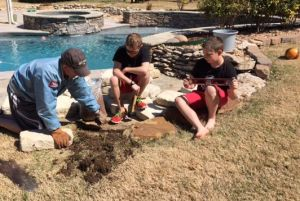 Steve Beatie building landscape wall with sons