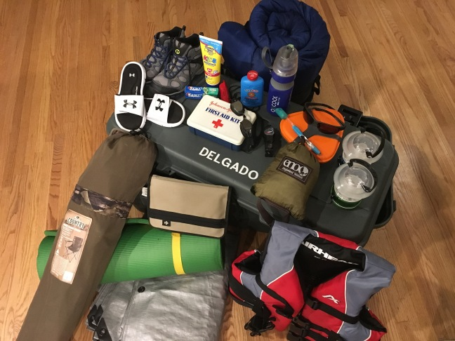 Hiking boots, sunscreen bottle, toothpaste, whistle, first aid kit, goggles, compass, mess kit, toothbrush, hammock, lanterns, sleeping bag, foot powder bottle, flip flops, nylon book cover, camp chair, sleeping pad, tarp, life preserver, foot locker.
