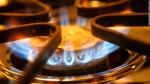 up close photo of gas top stove burner with blue flame