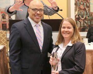 Dennis Kennedy, founder and chair, National Diversity Council, presents Cherie Humphries, vice president, Supply Chain, with a 2018 Top 50 Most Powerful Women in Oil and Gas award.