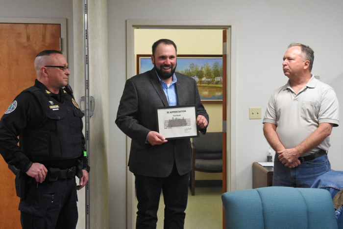 Photo courtesy of the Republican Herald used with permission. Tim Reed, center, is honored by Pine Grove Mayor Will Shiffer, right, and Pine Grove Police Chief Thomas Trotter, left.