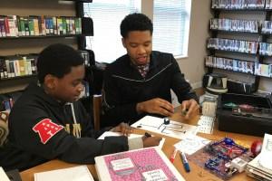 Youth using robotics program