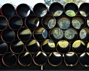 Pipes stacked in a yard