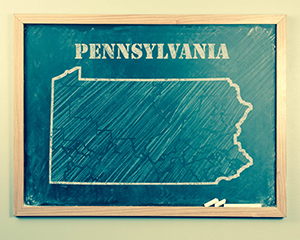 Outlined Pennsylvania US state on grade school chalkboard