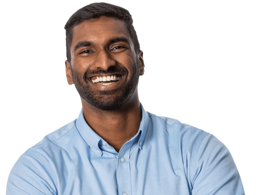 Man in light blue shirt smiling